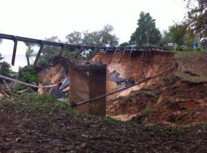 Pensacola road section collapses from flooding